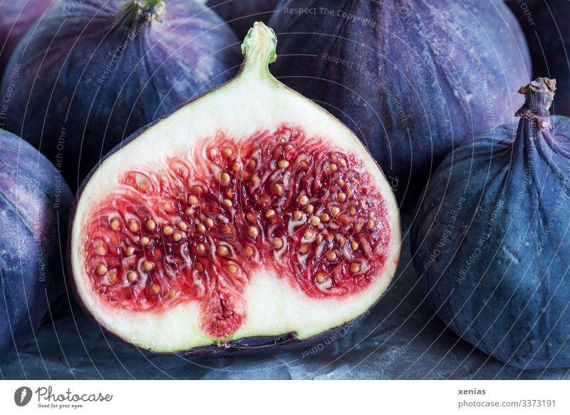 sliced juicy fig before other figs Fig Food fruit Nutrition Organic produce Vegetarian diet Diet Italian Food Fresh Healthy Glittering Delicious Juicy Sweet