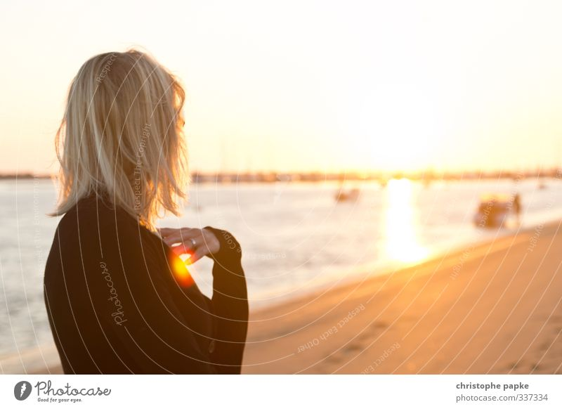 Young blonde woman looking at the sun on the beach Vacation & Travel Summer Summer vacation Sun Beach Ocean Feminine Young woman Youth (Young adults) Woman
