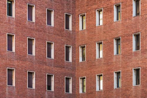 Symmetrical facades of a building Design Building Architecture Facade Brick Colour windows building facade urban old brick building urban facade exterior