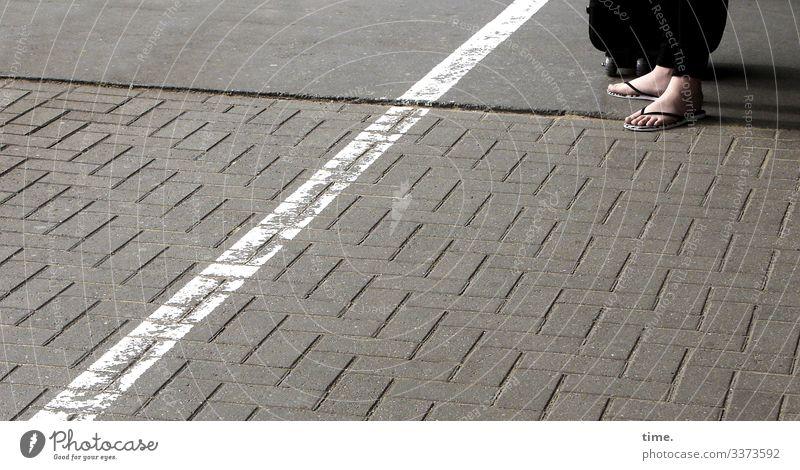 Patience on the platform Platform daylight feet Barefoot Woman Suitcase Flip-flops Stripe Asphalt Places stones Stand Wait patience Border Safety Protection