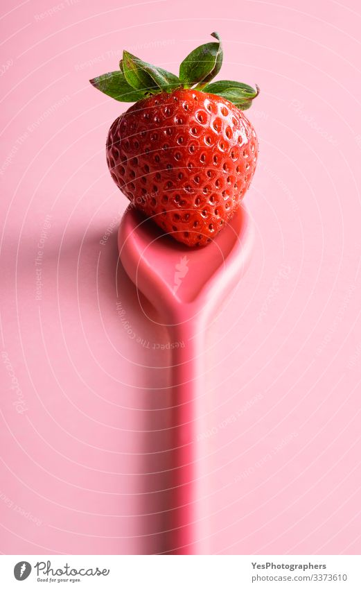 Single strawberry on a spoon. Ripe strawberry on pink Food Fruit Dessert Organic produce Spoon Fresh colorful cute fruit diet food fresh fruit fresh strawberry
