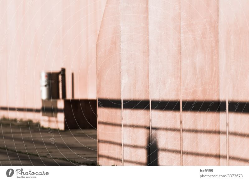 pink exposed concrete with shadow and trash can Concrete Facade Symmetry Concrete wall Stripe Art Surrealism Creativity Handrail Manmade structures Modern