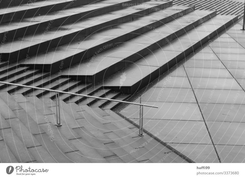 monotonous staircase landscape in the rain Long shot Central perspective Shadow Light Morning Structures and shapes Pattern Abstract Detail Exterior shot