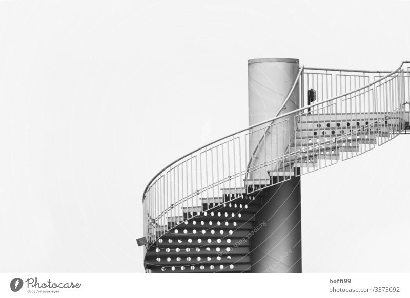 Profile of a spiral staircase with fine-linked banister and visible perforated undersides of the steps Clouds Bad weather Architecture Manmade structures Town