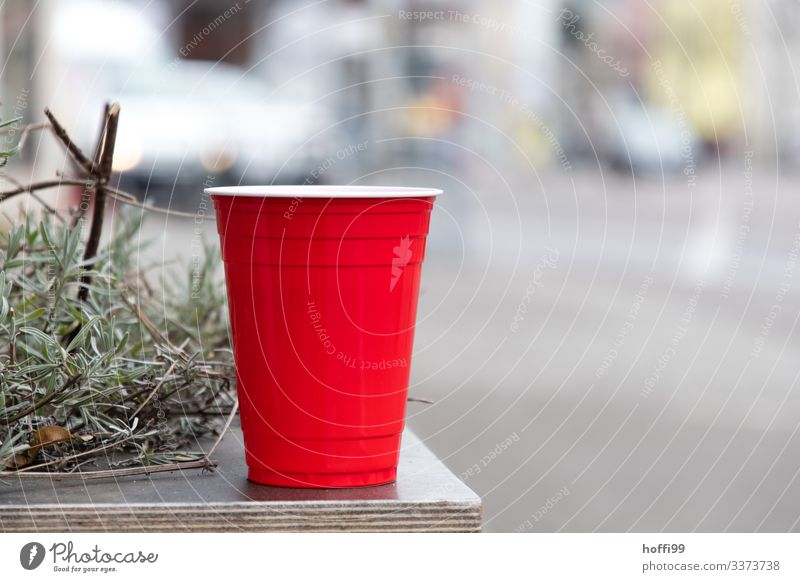 red plastic cup with rosemary on a table Red red cup Plastic cup Trash plastic waste environmental impact Isolated Image Rosemary selective focus