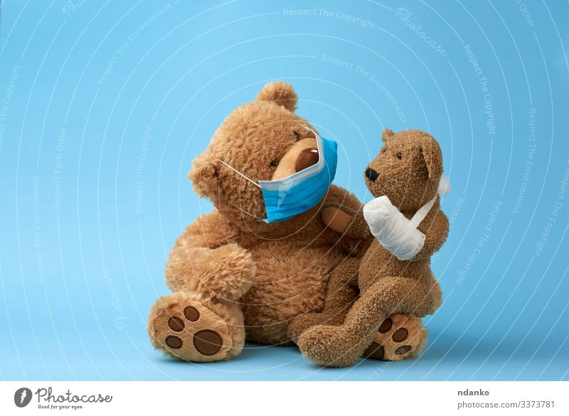 big brown teddy bear sits in a medical mask Joy Illness Medication Hospital Baby Infancy Animal Paw Toys Doll Teddy bear Sadness Small Funny Cute Soft Blue