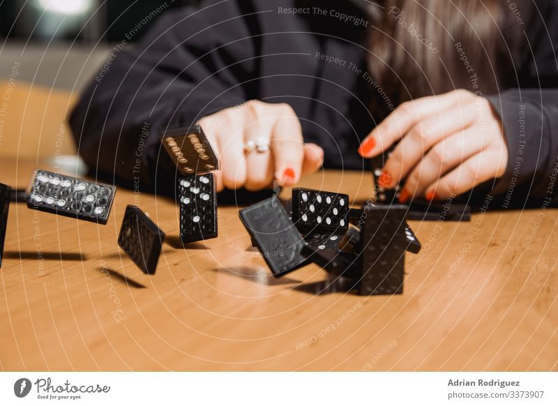 The wooden domino blocks falling down Playing Game of cards Poker Lottery Business Shopping Crash Effect Balance failure gambling strategy casino Downward