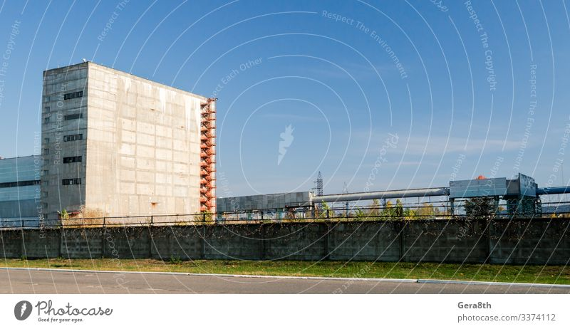 high nuclear waste storage building in Chernobyl Sky Vacation & Travel Plant Blue Clouds Street Autumn Grass Building Tourism Trip Threat Seasons Fence Trash
