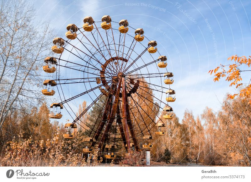 old carousel wheel in an abandoned amusement park in Chernobyl Sky Vacation & Travel Nature Old Blue Landscape Red Tree Leaf Autumn Yellow Tourism Trip Park