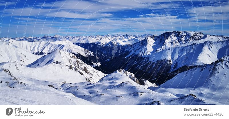 sea of peaks in the snow Panorama (View) Light Deserted Movement Far-off places Snowcapped peak Mountain Nature Landscape Sky Alps skis Ischgl Summit Paradise
