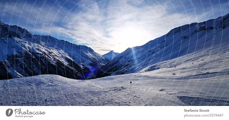 Piste paradise at sunset Panorama (View) Light Deserted Movement Far-off places Snowcapped peak Mountain Sunset Nature Landscape Sky Alps Sölden skis Ski route