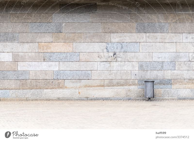 Garbage can in front of sandstone wall with fading graffito Diagonal Wall (building) Brick Minimalistic Pecking order Stagger Stairs Approach to the stairs