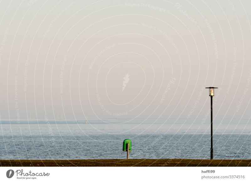 minimalistic view of lantern with garbage can at the sea Nature Water Cloudless sky Sunrise Sunset Spring Summer Beautiful weather Grass Coast North Sea