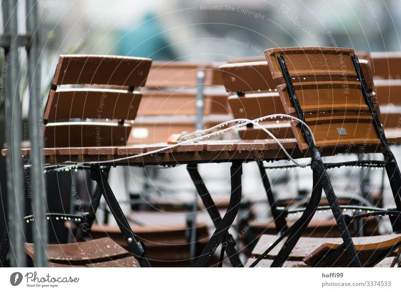 connected chairs and table in the rain Chair minimalism Minimalistic Folding chair Group of chairs Stack Stack of chairs Steel Modern Gloomy Gray Clean