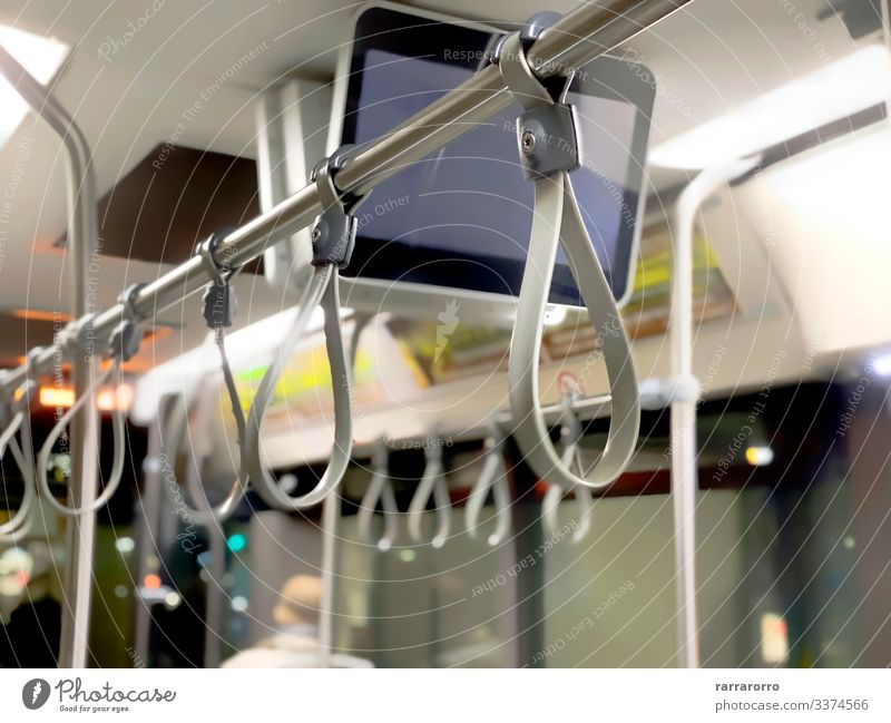 A row of gray bus handles Contentment Vacation & Travel Tourism Trip Transport Public transit Vehicle Railroad Underground Tram Metal Steel Plastic Hang Stand
