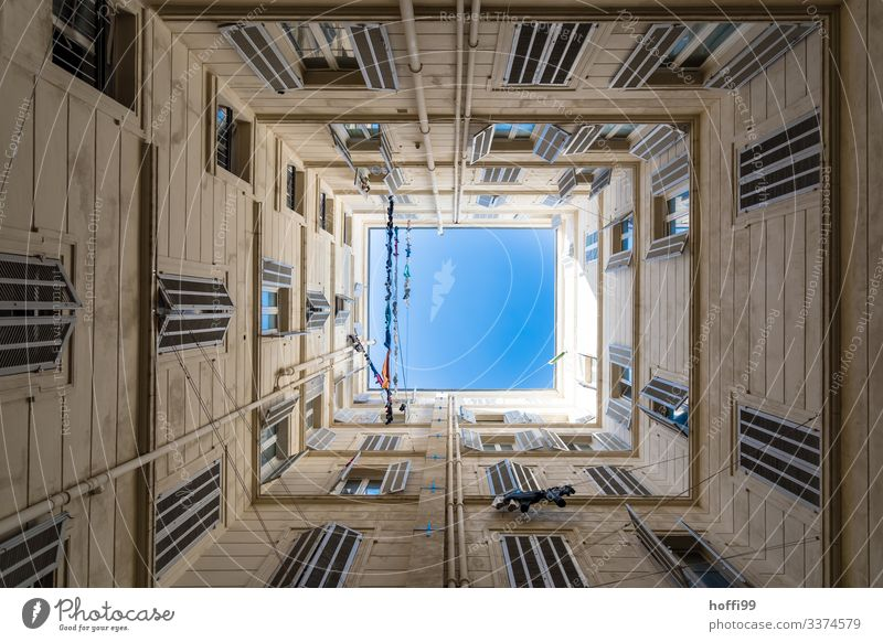 View up in a square courtyard with clotheslines and a deep blue sky Beautiful weather House (Residential Structure) Interior courtyard Wall (barrier)