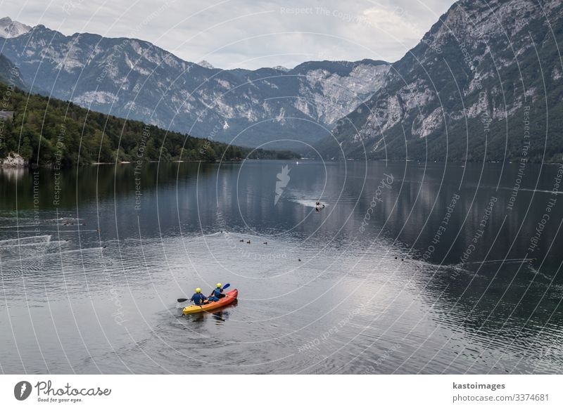 People rowing in Bohinj lake, Alps mountains, Slovenia. Woman Human being Vacation & Travel Nature Man Beautiful Landscape Clouds Forest Mountain Lifestyle