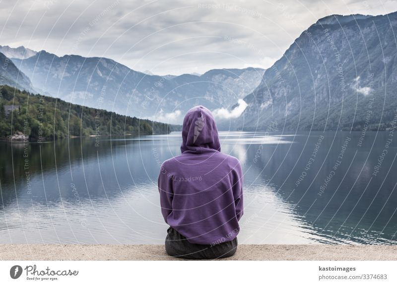 Sporty woman watching lake Bohinj, Alps mountains, Slovenia. Woman Human being Sky Vacation & Travel Nature Beautiful Landscape Relaxation Clouds Forest