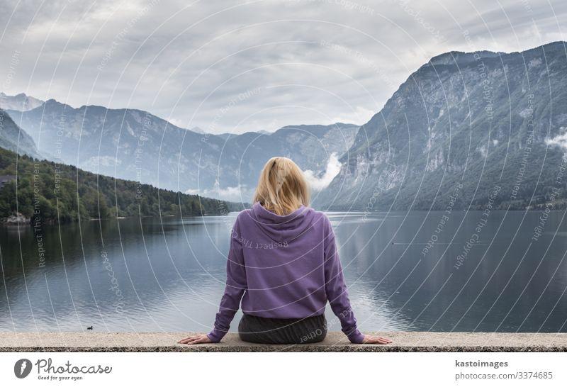 Sporty woman watching lake Bohinj, Alps mountains, Slovenia. Lifestyle Beautiful Relaxation Vacation & Travel Tourism Mountain Human being Woman Adults