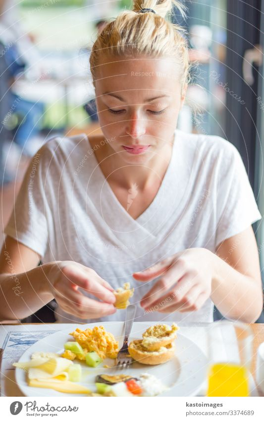 Woman eating delicious healthy breakfast. Vacation & Travel Beautiful Hand Street Eating Adults Tourism Fresh To enjoy Delicious Vegetable Tradition Breakfast
