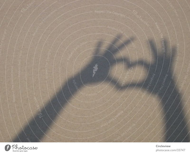 Heart shadow on the beach Happy Summer Sun Human being Hand Sand Love Emotions Shadow play Women`s hand Sincere Public Holiday play with light Light