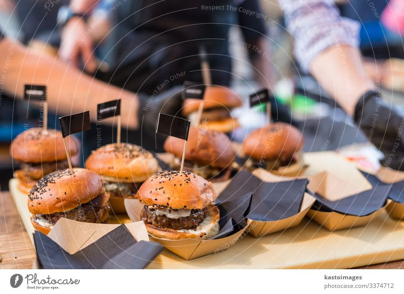 Chef making beef burgers on food festival event. Meat Roll Lunch Plate Desk Kitchen Restaurant Street Gloves Going Make Delicious Black catering chef Beef