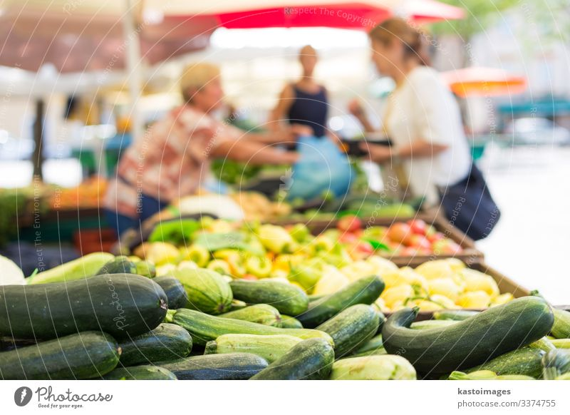 Blured unrecodnised people buying vegetable at farmers' market. Food Vegetable Nutrition Vegetarian diet Shopping Garden Decoration Woman Adults Marketplace