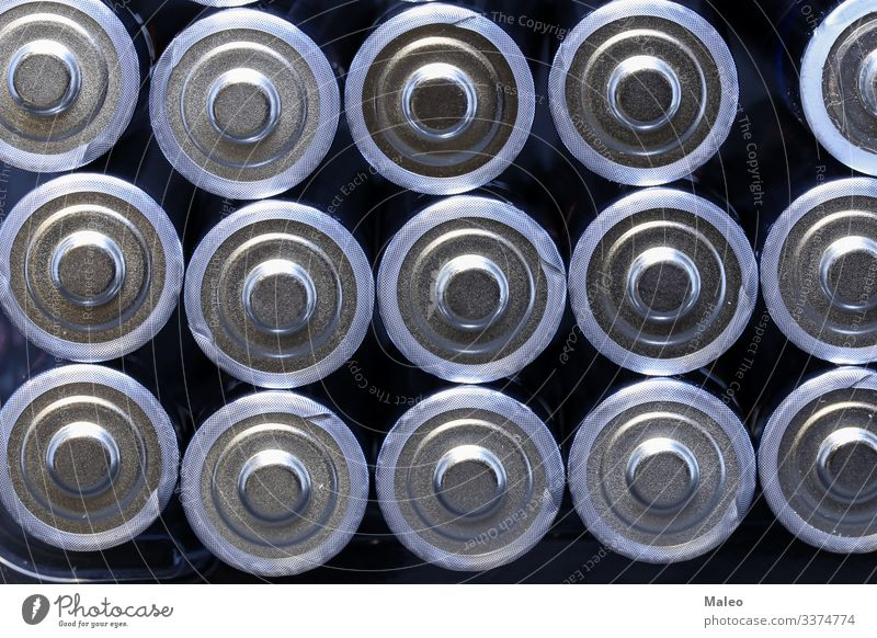 Several new alkaline batteries in one size in rows Battery Alkaloid Raw materials and fuels Energy industry Electricity Electronics Isolated (Position) Cargo