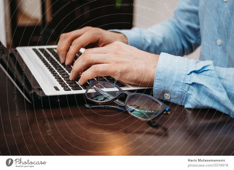 man typing hands on laptop with glasses on the desk Notebook Keyboard Technology Advancement Future Man Adults Hand Fingers 1 Human being 18 - 30 years