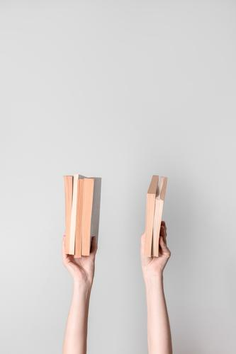 Female hands holding books knowledge arms fingers female girl woman young student teacher teaching reader librarian study studying pages white beige gray grey