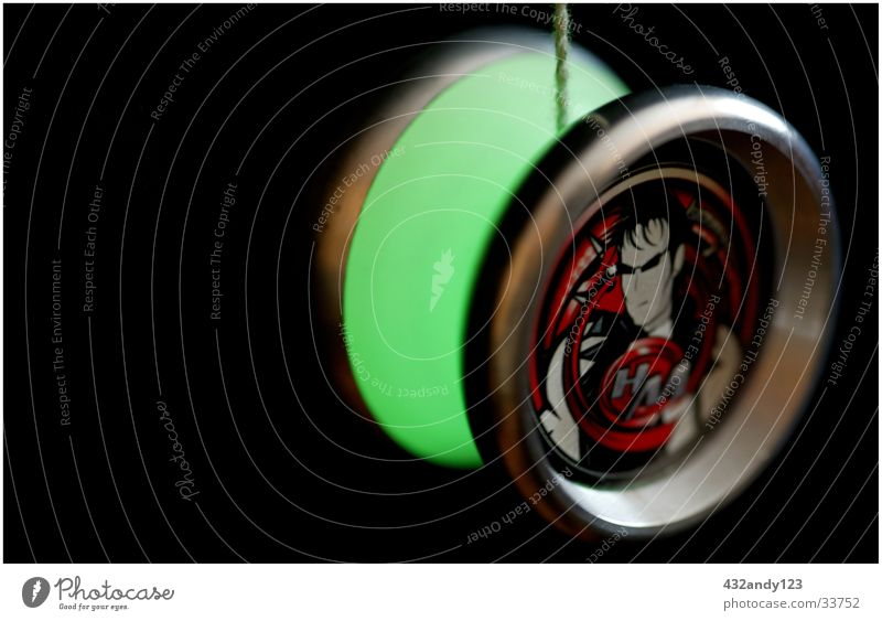 YOYO Hitman Long exposure Blur Yoyo Illuminant Bright Colours Bright green Dark background Isolated Image Object photography Copy Space left Thorough Circular
