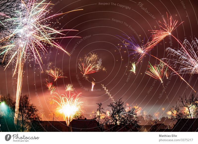 Fireworks on New Year's Eve Joy Brown Multicoloured Firecracker Long exposure Explosion Tracer path Feasts & Celebrations Public Holiday
