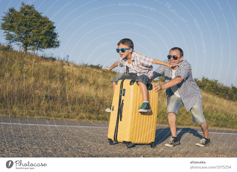 Father and son playing on the road at the day time. People having fun outdoors. Concept of happy vacation and friendly family. Lifestyle Joy Happy Playing