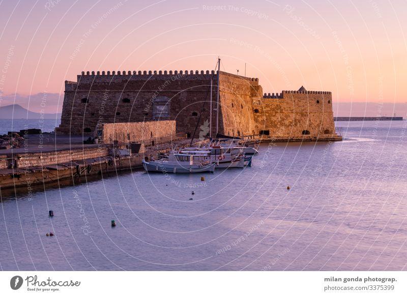 Heraklion Crete Greece Mediterranean Greek Europe landscape sea maritime harbour port tourism travel morning sunrise fortress castle Venetian boats