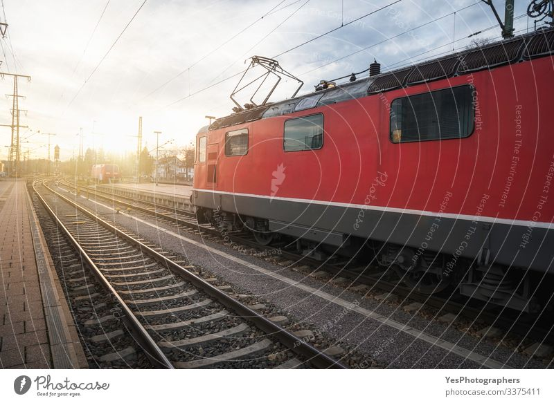 Red locomotive on railway tracks in german train station Vacation & Travel Machinery Beautiful weather Train station Transport Means of transport