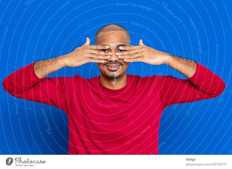 African man with red T-shirt Hair and hairstyles Human being Man Adults Afro Blue Red Black White Colour Guy Look out keep watch observe eyes Watchman gossiping