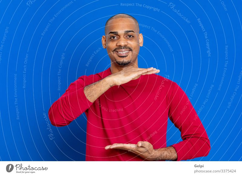 African man with red T-shirt Hair and hairstyles Human being Man Adults Hand Fingers Afro Blue Red Black White Colour Guy point Indicate indicating