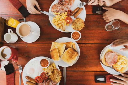 Young Happy Family Having Breakfast Fruit Bread Croissant Jam Eating Beverage Juice Coffee Plate Lifestyle Vacation & Travel Table Kitchen Stone Gray scenery
