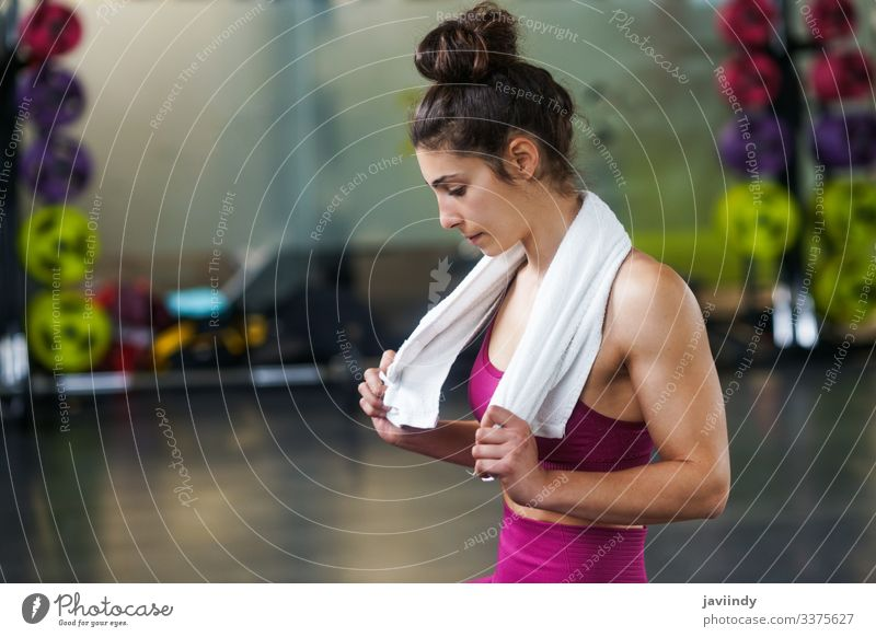 Woman Resting After Exercises at the Gym woman towel rest break girl resting exercise young sitting active gym fitness sport female health lifestyle portrait