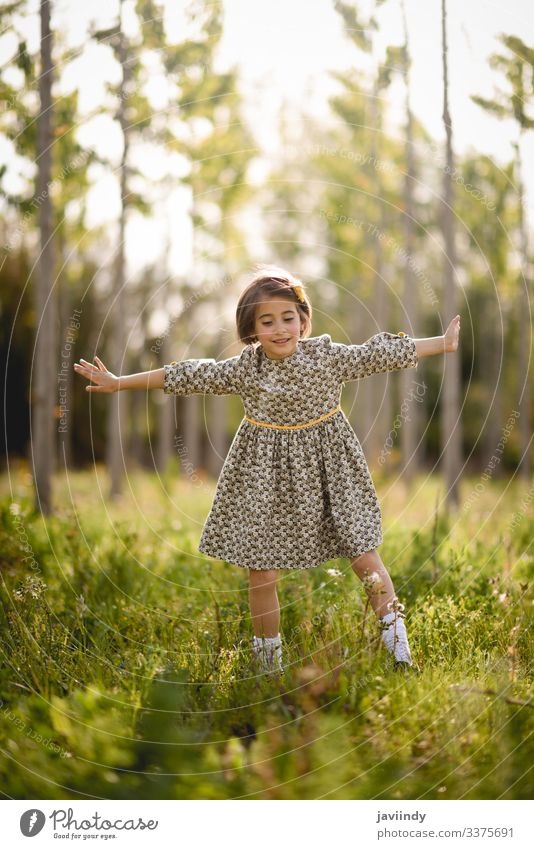 Little girl in nature field wearing beautiful dress little child happy children spring outside summer meadow playing portrait outdoor fashion happiness baby