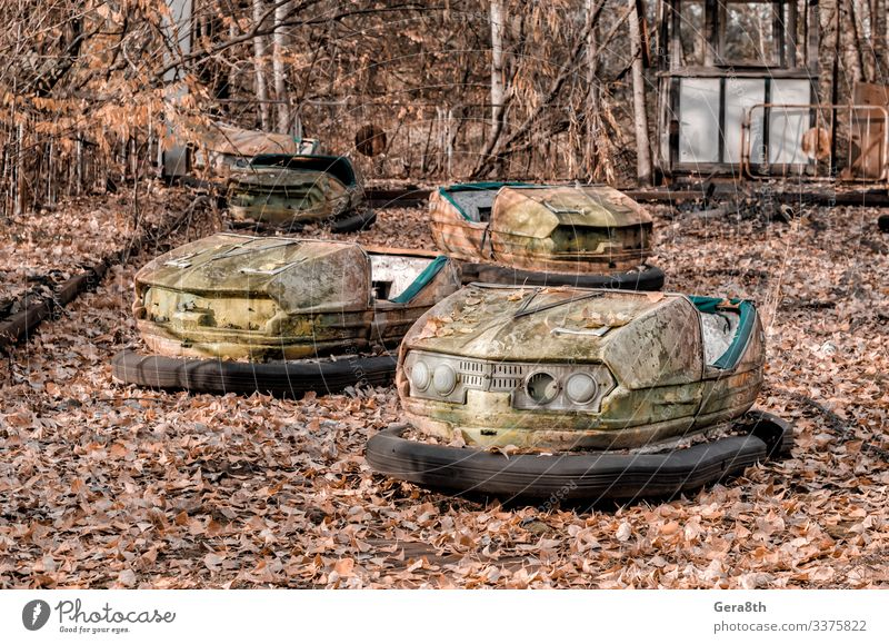 cars in an abandoned amusement park in Chernobyl Vacation & Travel Tourism Trip Nature Plant Autumn Tree Leaf Park Transport Car Rust Old Threat Retro Dangerous