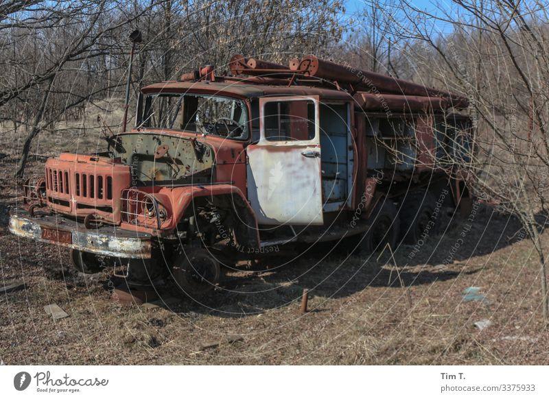 FIRE WEAR Rush hour Vehicle Truck Fire engine Creepy Historic Environmental pollution Decline Past Transience Ukraine Colour photo Exterior shot Deserted