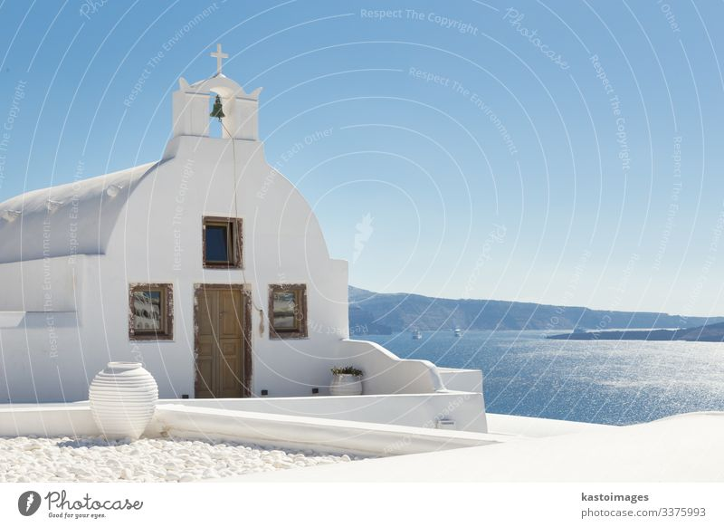 Traditional white orthodox church in Oia, Santorini, Greece. Beautiful Tourism Sun Ocean Island Sky Tree Volcano Village Town Church Architecture Concrete Wood