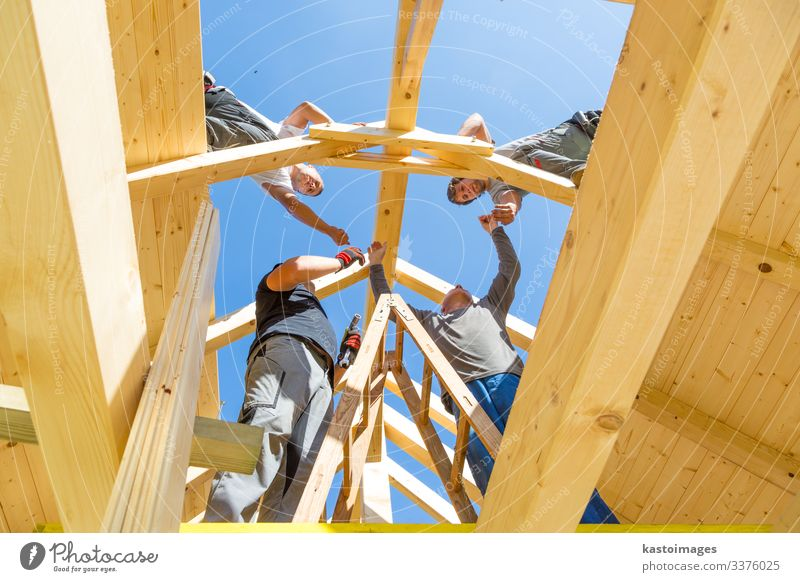 Builders at work with wooden roof construction. House (Residential Structure) Work and employment Craftsperson Construction site Industry Tool Hammer