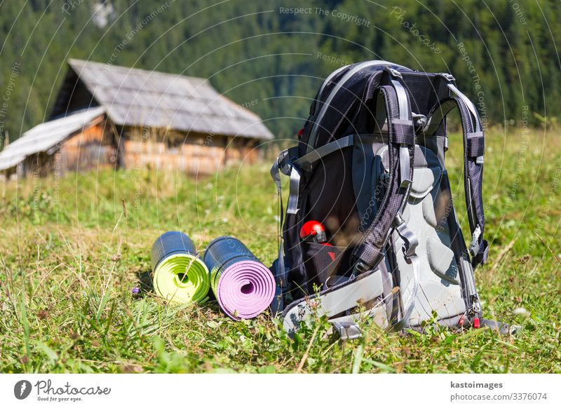 Backpack and yoga mats on mountain meadow. Vacation & Travel Tourism Trip Adventure Camping Mountain Hiking House (Residential Structure) Sports Nature Grass