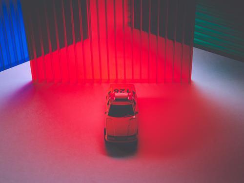 A security car between colors lights Transport Means of transport Car Esthetic Apocalyptic sentiment Colour photo Multicoloured Studio shot
