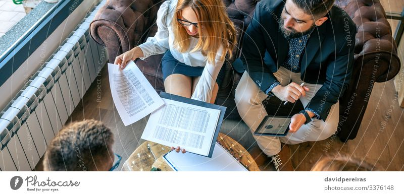 Top view of informal work meeting sitting on sofa Work and employment Office Business Company Internet Human being Woman Adults Man Group Plant Cactus Aircraft