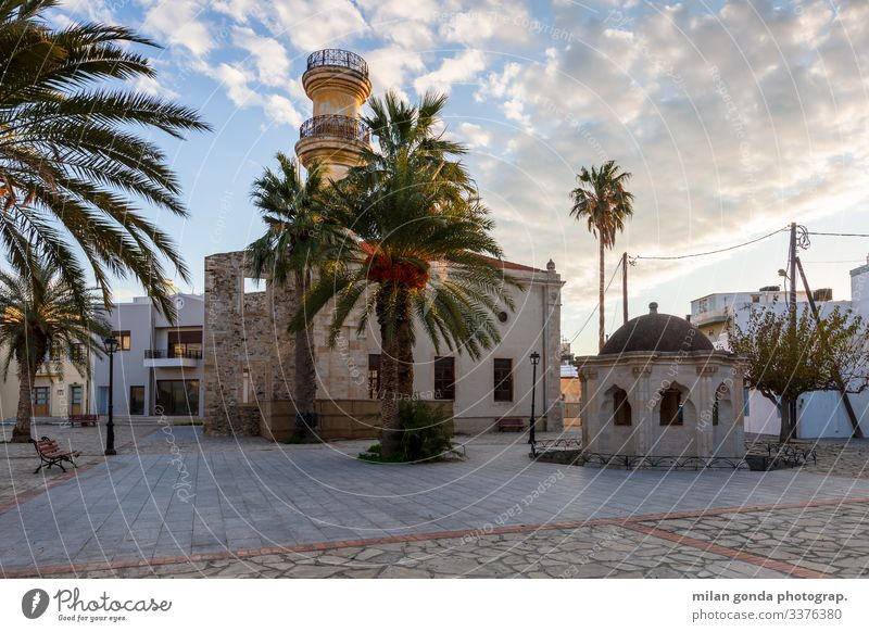 Mosque in Ierapetra, Crete. Europe Mediterranean Greece Greek Lasithi town square street cityscape architecture fountain palm trees palms mosque Ottoman Minares