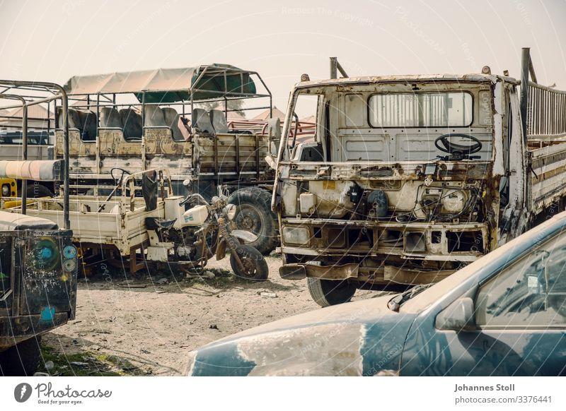 Rusty wrecks at car graveyard in Africa junkyard Wrecked car Dismantle metal Iron Steel Recycling waste Disposal storage repositories Sand Desert Senegal Truck