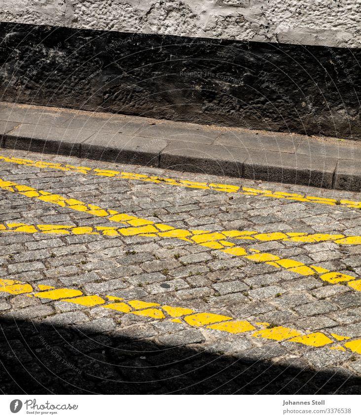street art Asphalt Tar Concrete Paving stone Cobblestones Lane markings Yellow Wall (building) Facade Black Gray curb highlighter Crucifix Parking lot